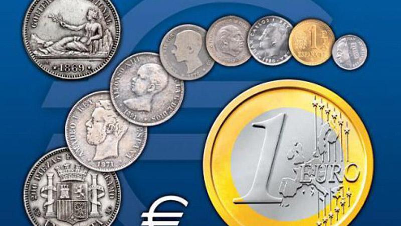 Diferentes monedas europeas anteriores al euro y una moneda de un euro